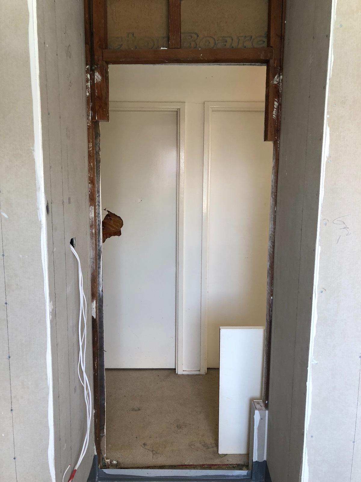 Bathroom door - wall tiling to door jam