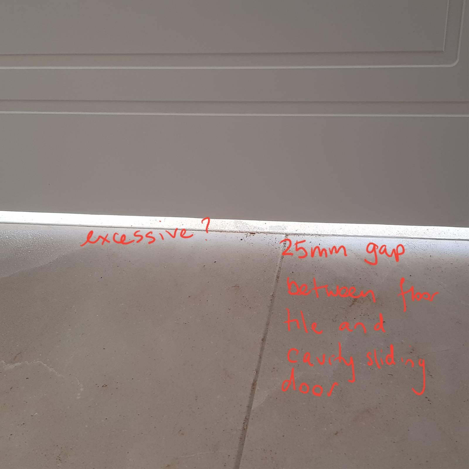 Excessive gap between tiled floors in bathroom and cavity sl