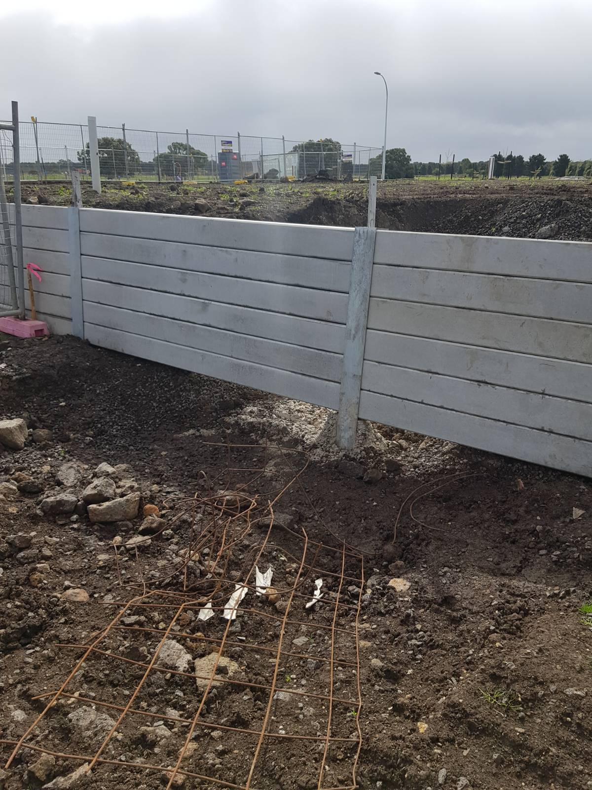 Developer's retaining wall and New home adices