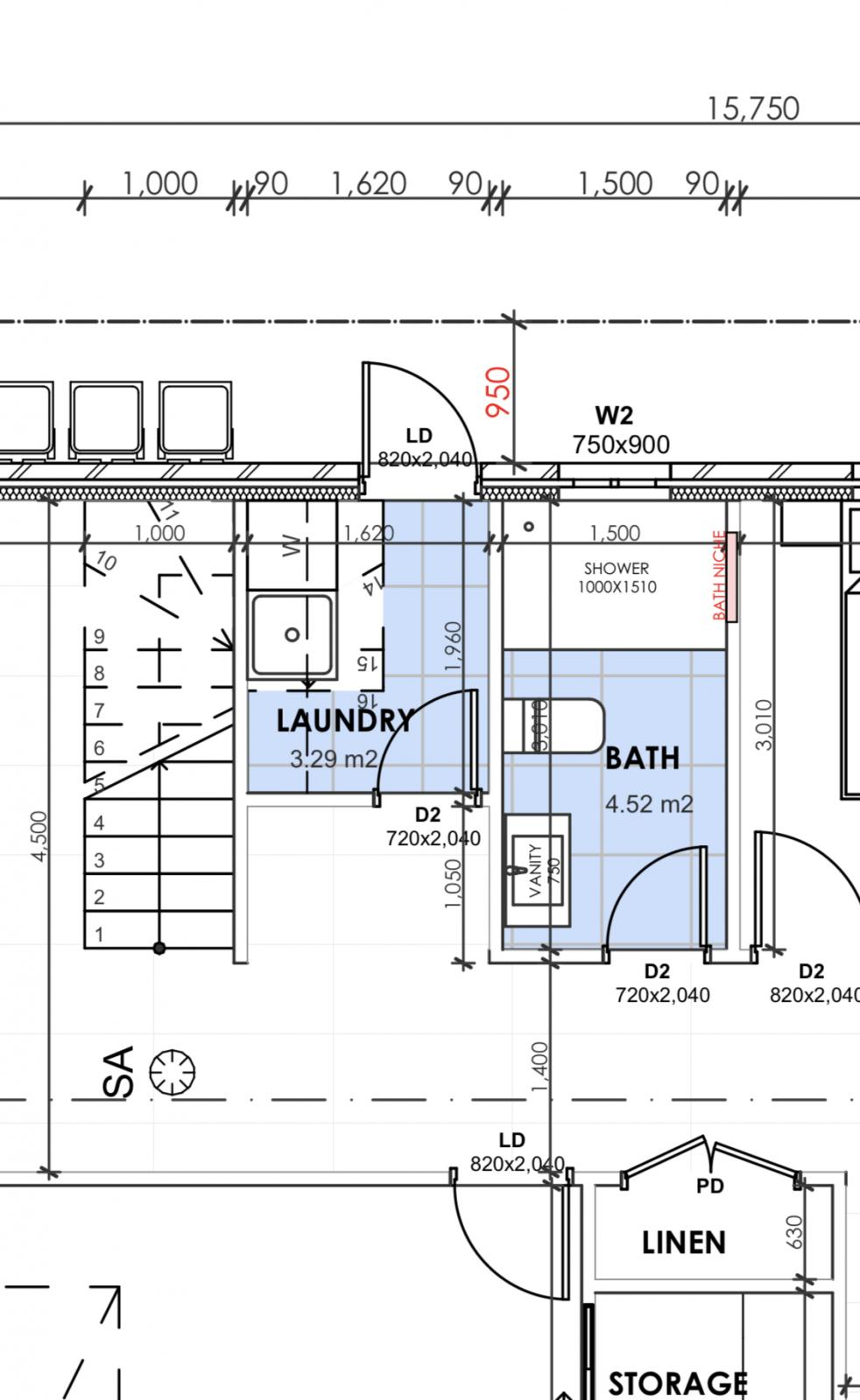 Small laundry room under stairs