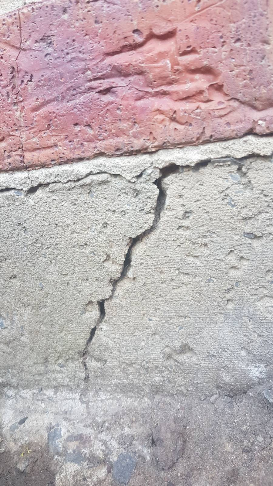 house slab cracking on corner of house.