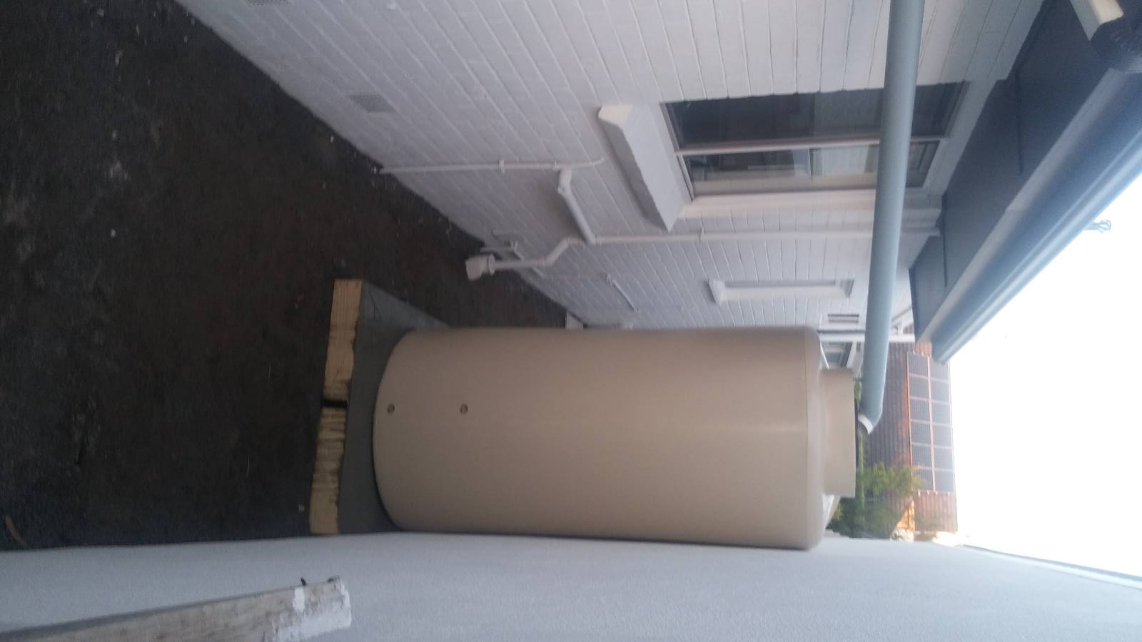 Neighbour installed water tank right next to my garage wall!