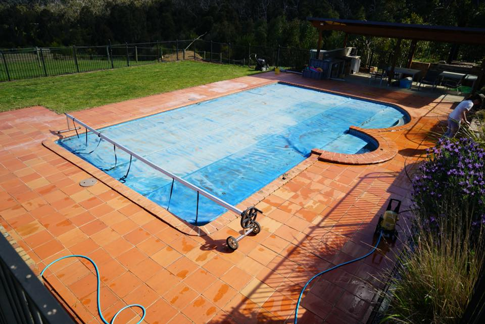 Painting tiles around a pool area