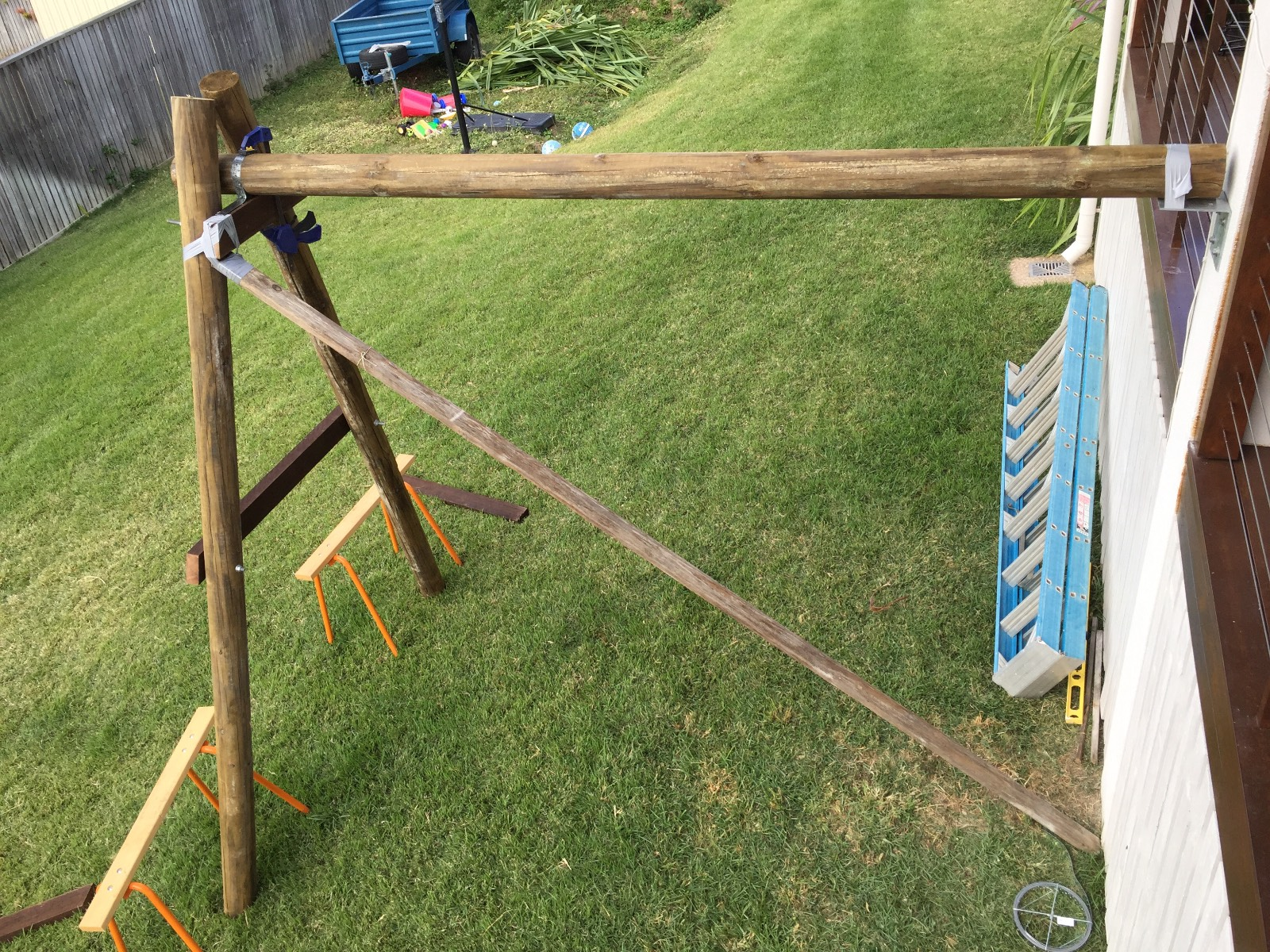 Attaching kids swing to side of house - is this ok?