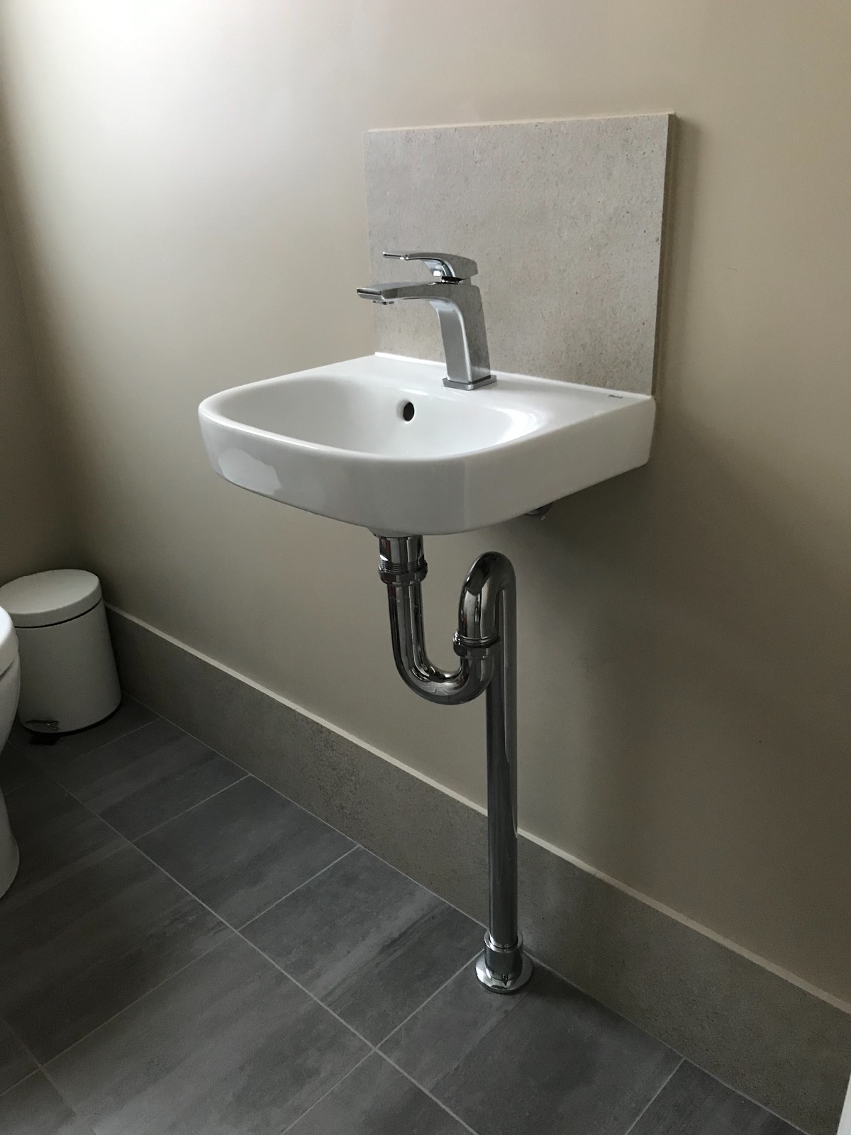 Sink in seperate toilet or combine with main bathroom?
