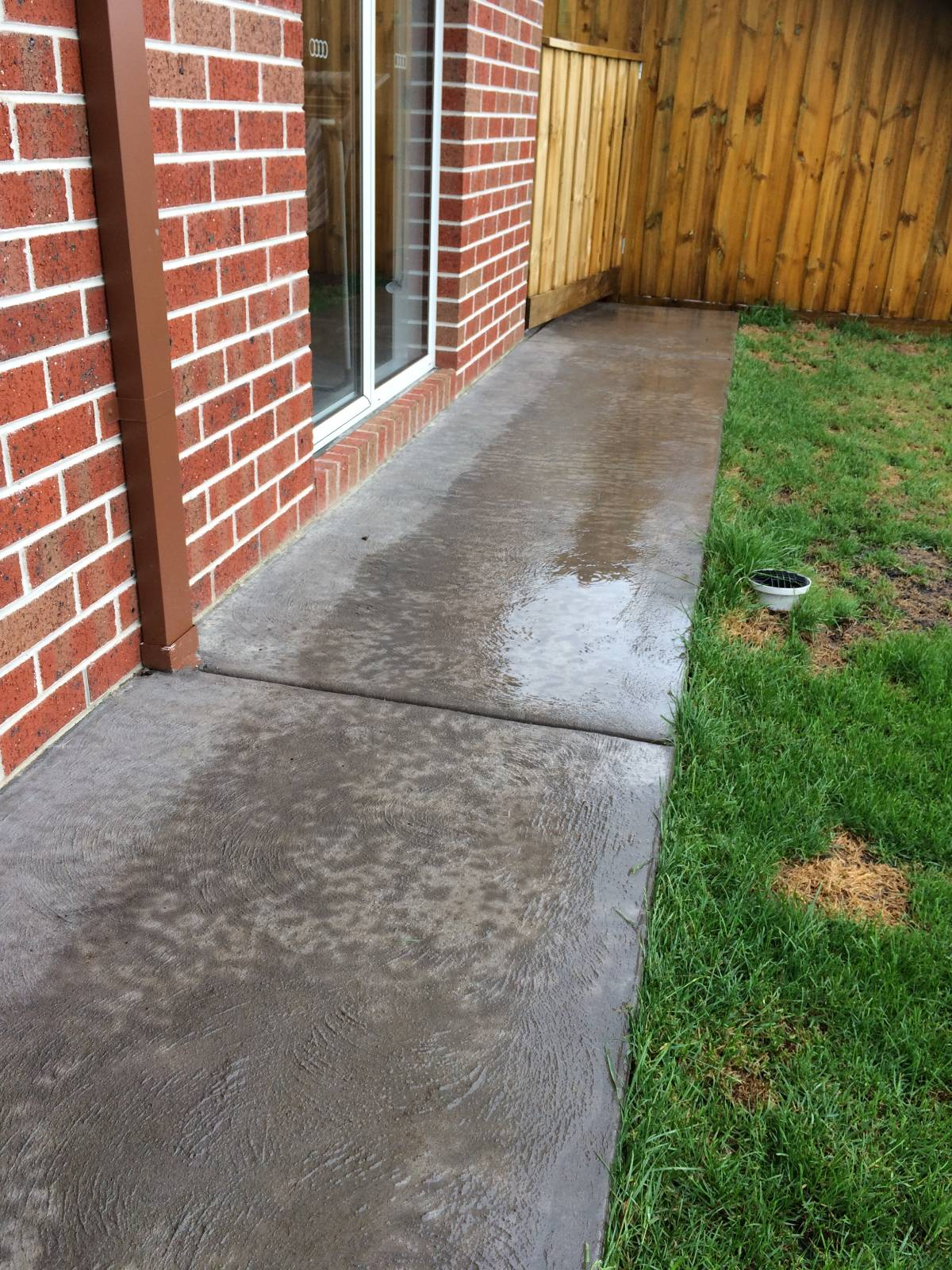 Photos of 50mm fall to concrete apron