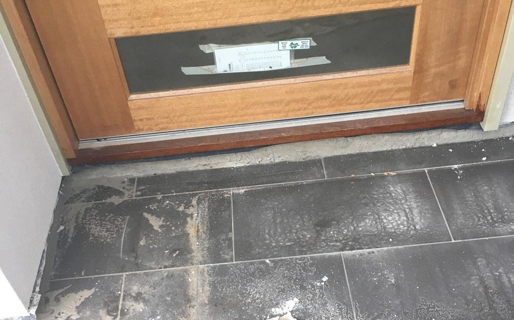 Slab showing between front door and porch