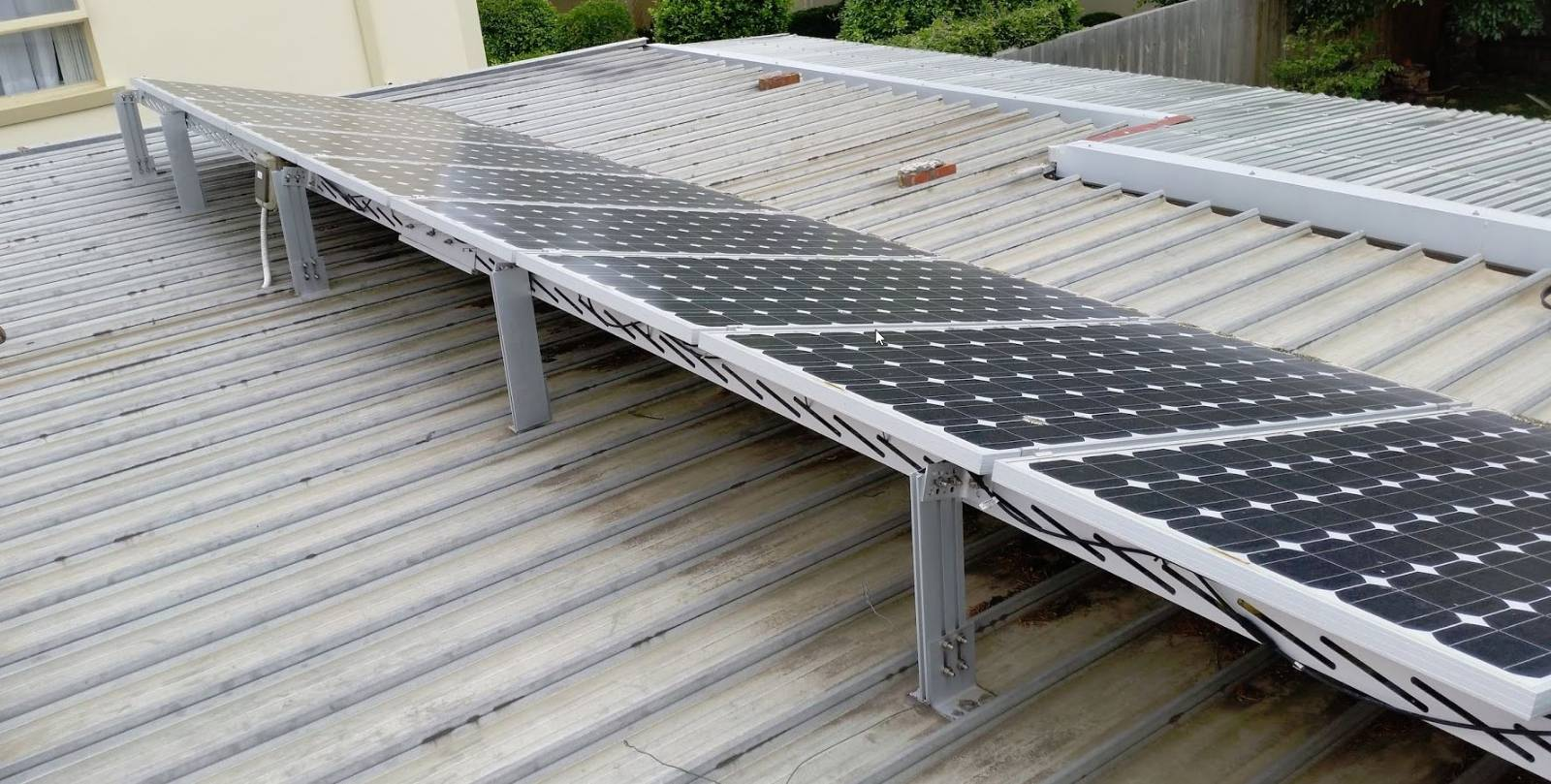 Flat roof + Solar panels - Is it possible?