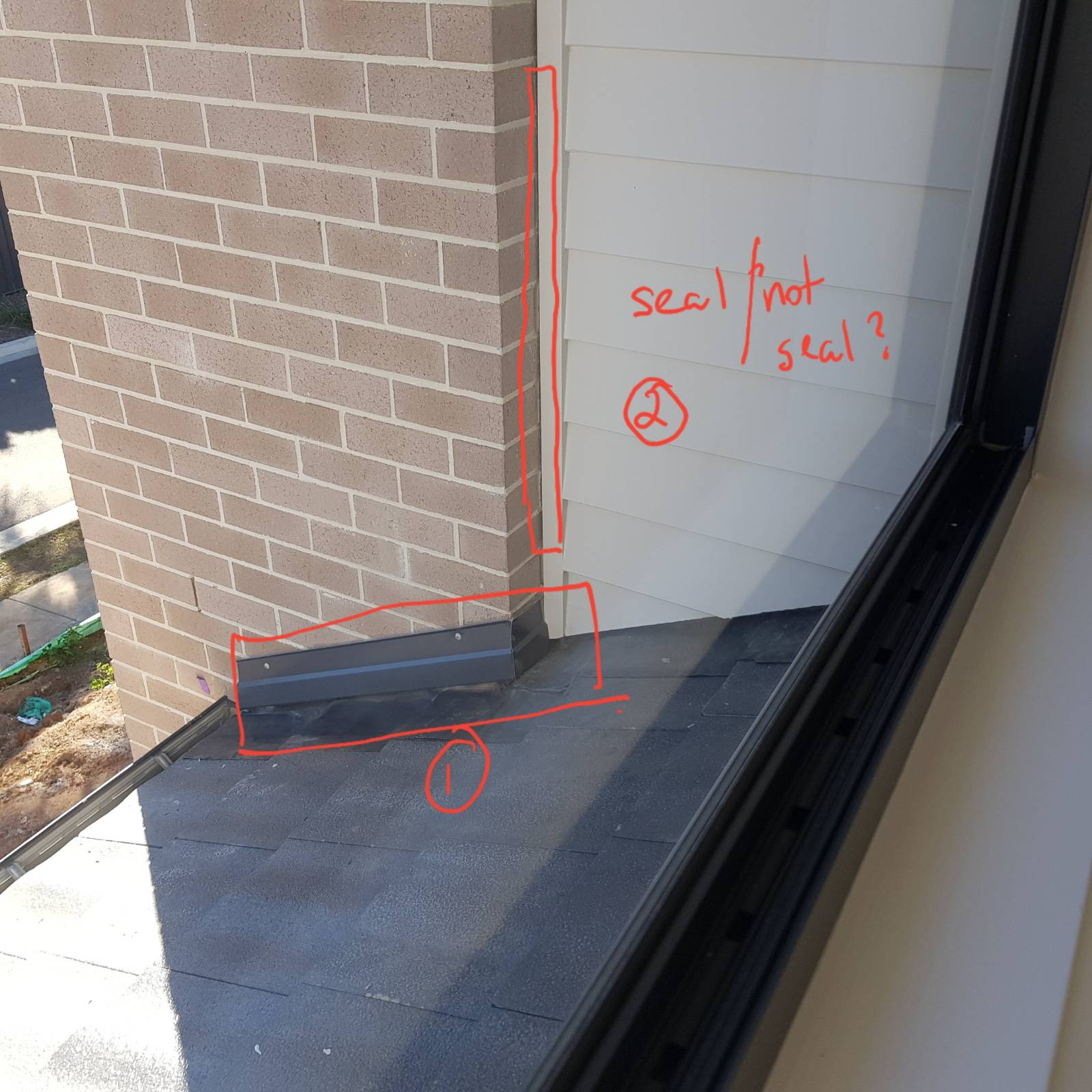 Roof flashing not built into brickwork???