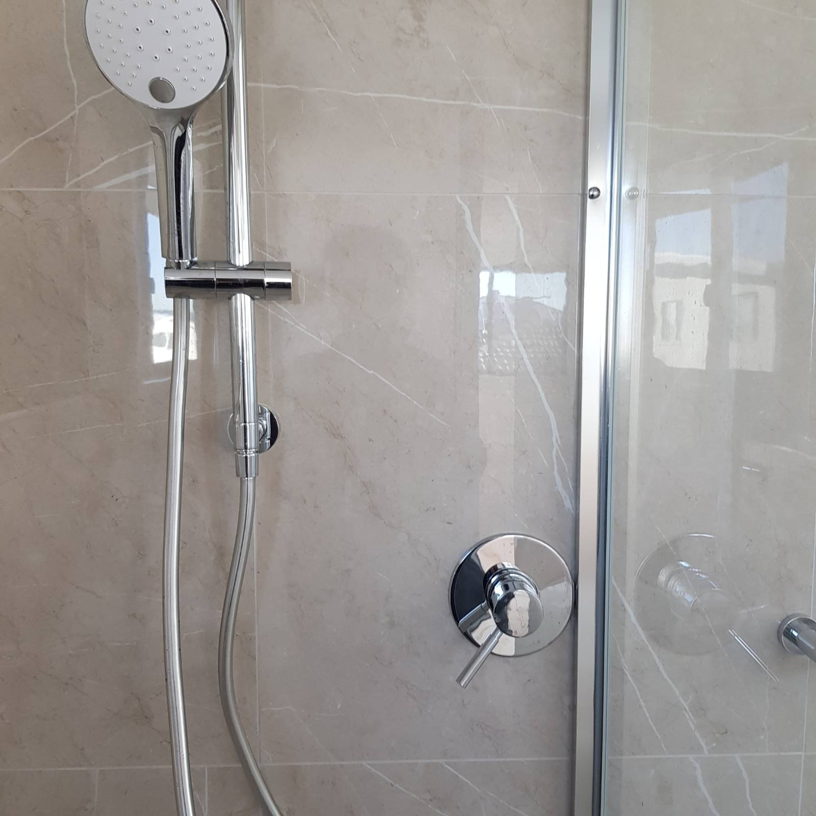 Shower mixer tap touching shower frame...thoughts?