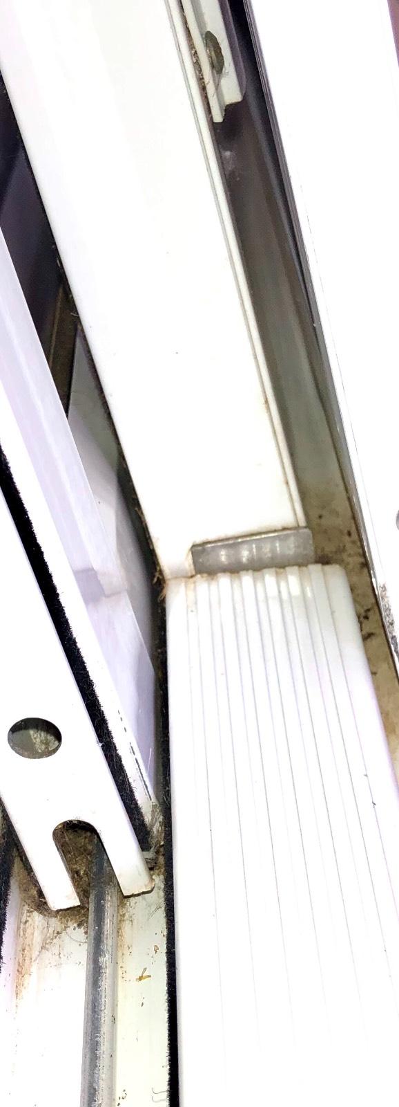 Help with identifying metal part on sliding door/ glass wind