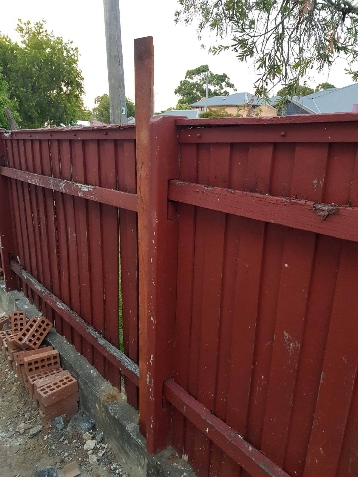 Timber fence but short concrete posts (see pic)
