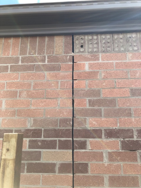 Quality of brickwork under render - what is acceptable?
