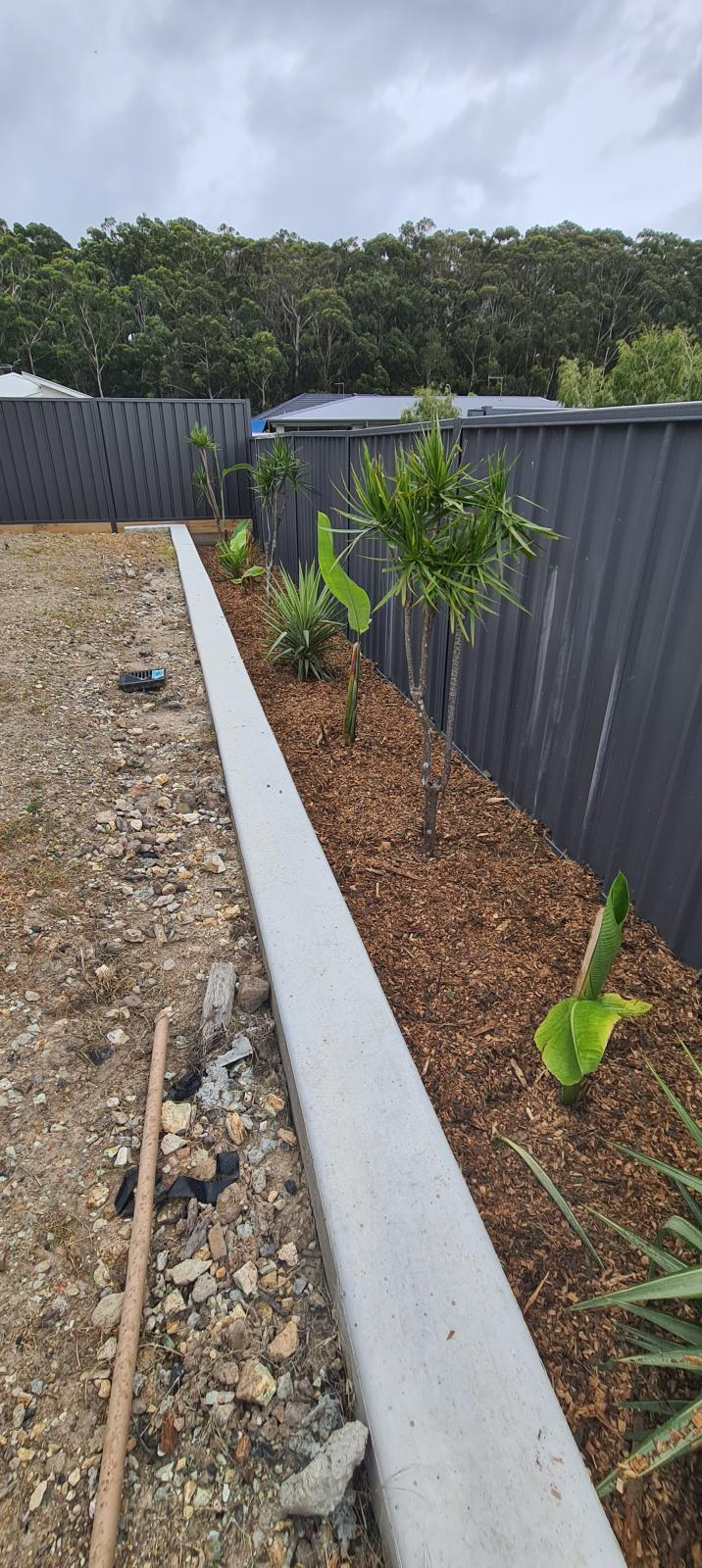 Adding to concrete retaining wall