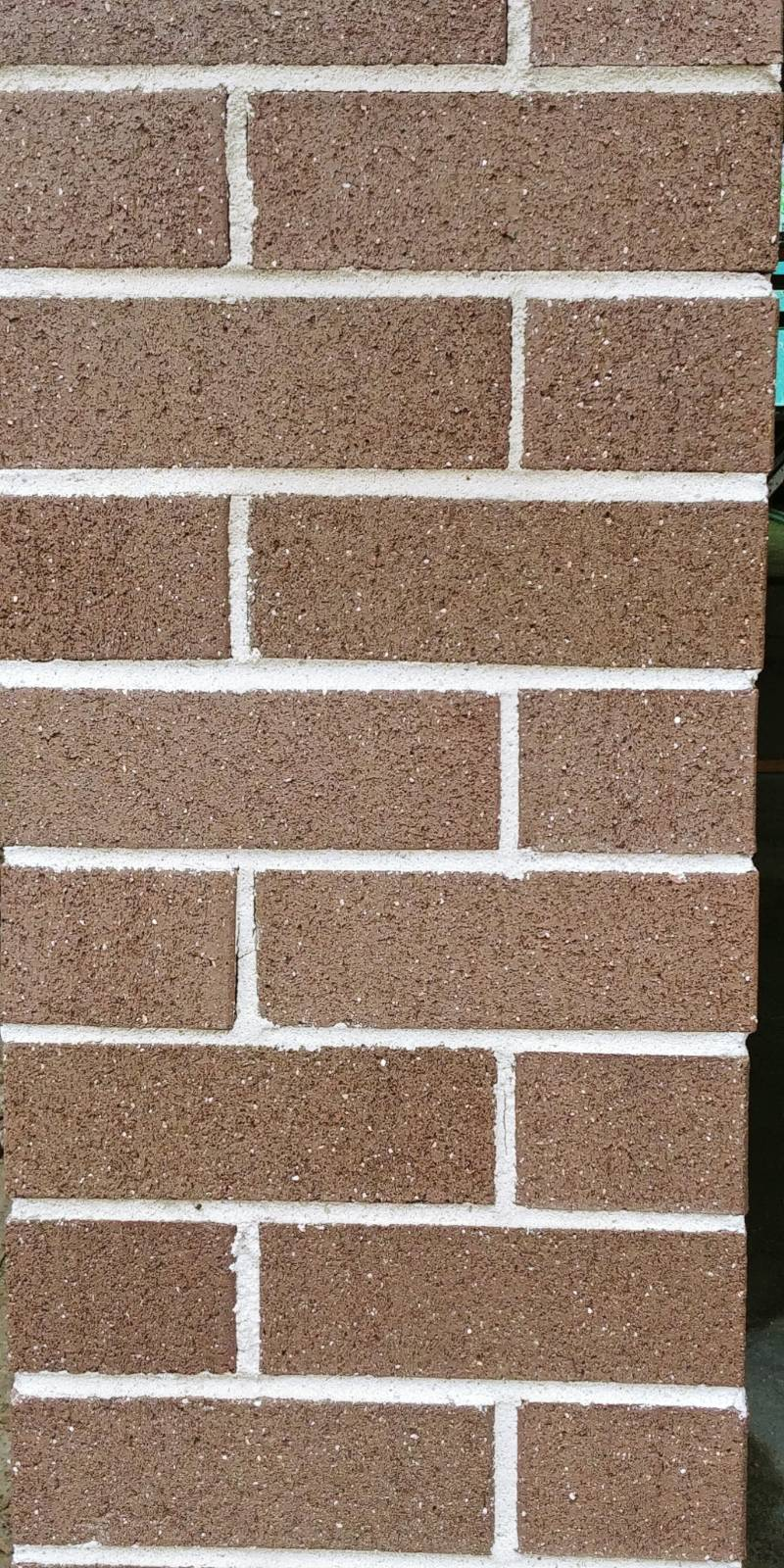 which side of the brick faces external facade?