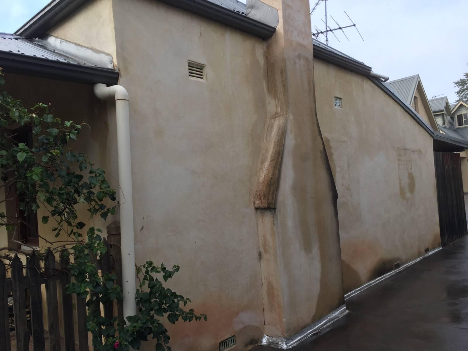 Concrete slab driveway next to house